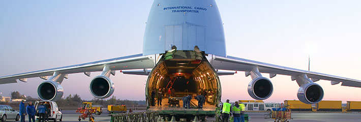 workers unloading a cargo plane