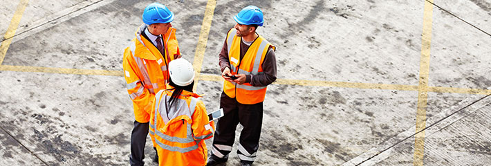 Consulting with clients on a construction site
